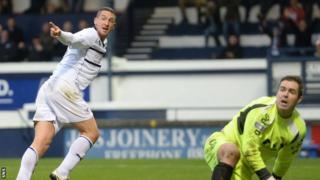 Calum Elliot celebrates scoring Raith's second goal against Annan