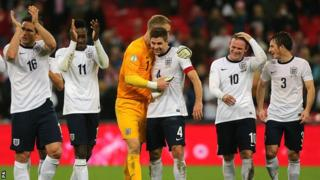 England players celebrate qualification for the 2014 World Cup in Brazil