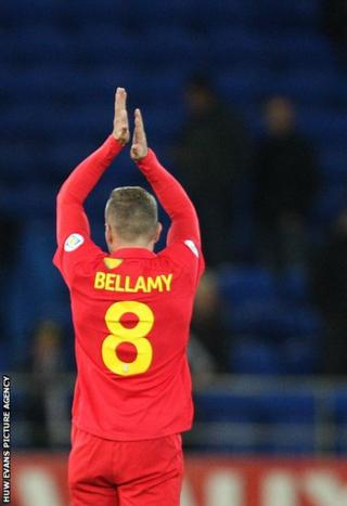 Bellamy acknowledges the Welsh supporters following his final home game, a 1-0 win over Macedonia at Cardiff City Stadium.