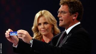 Jerome Valcke and Charlise Theron at the World Cup draw in 2009