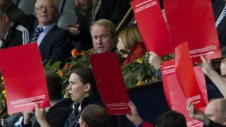 Michael Johnston views protests against him