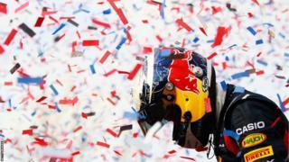 Sebastian Vettel celebrates winning his second successive world title