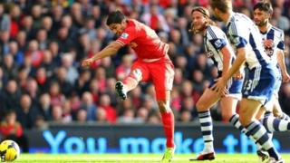 Luis Suarez scores the opening goal against West Brom