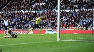 Birmingham's Lee Novak (centre) scores an equaliser at Derby