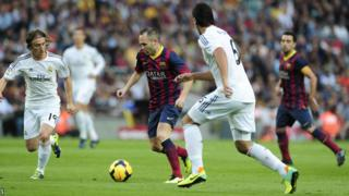 Barcelona midfield duo Andres Iniesta and Xavi dominated possession in El Clasico against Real Madrid