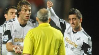 Michu and Neil Taylor make their point at the end of the game