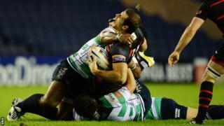Edinburgh's Tim Visser is injured against Treviso