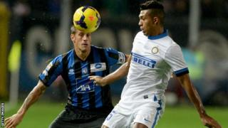 Atalanta's German Denis, left, challenges Juan Jesus of Inter Milan.