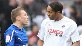 Ashley Williams and Craig Bellamy chat following the last derby match bewteen Cardiff City and Swansea City