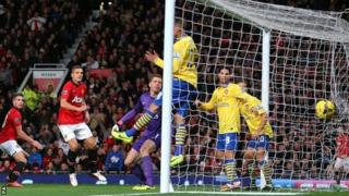 Robin van Persie (far left) scores for Manchester United