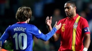 Ashley Williams (right) shakes hands with Croatia's Luka Modric in March, 2013