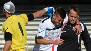 A Nocerina player goes off injured against Salernitana