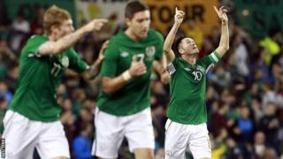 The Republic of Ireland's Robbie Keane celebrates scoring against Latvia