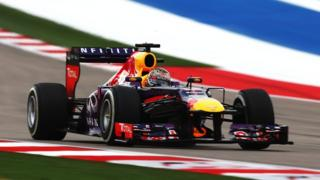 Red Bull's Sebastian Vettel claims pole position for the United States Grand Prix at the Circuit of the Americas.