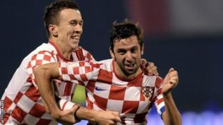 Darijo Srna (right) celebrates scoring the second goal with Ivan Perisic