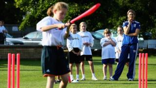 England's Charlotte Edwards taking a cricket session with schoolgirls