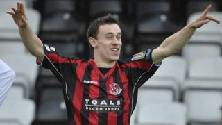Crusaders Paul Heatley celebrates scoring against Coleraine at Seaview