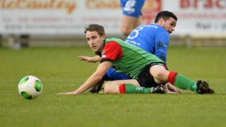 Glentoran's Johnny Addis and Stuart Hutchinson of the Mallards in action in the Irish Premiership on Saturday
