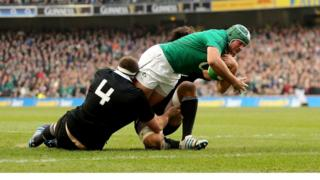 Ireland hooker Rory Best stretches to score the second try of a drama-filled match against the world champions