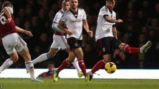 Joe Cole curls home West Ham's third goal