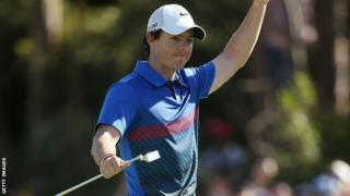 Rory McIlroy celebrates after holing the winning putt on the 18th