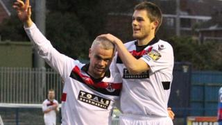 Gary McCutcheon is congratulated by Crusaders team-mate Craig McClean after scoring in the 4-1 win over Ards