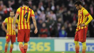 Barcelona's Neymar and team-mates look dejected after losing their Spanish League soccer match against Athletic Bilbao