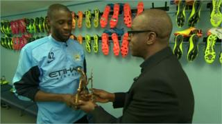 Yaya Toure with BBC trophy