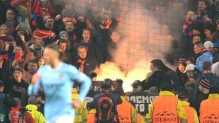 CSKA Moscow fans let off a flare during their team's Champions League tie at Manchester City in November 2013
