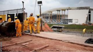 Workers constructing the Arena de Sao Paulo.