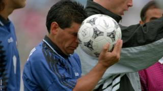 Argentina's Diego Maradona with the Questra, the official match ball of the 1994 World Cup in the United States.