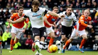 Chris Martin scores from the penalty spot during Derby's 5-1 win over Blackpool