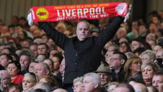 A Liverpool fan at Anfield marking the 24th anniversary of the Hillsborough disaster