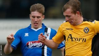 Grimsby's Dayle Southwell and Newport's Alex Gilby