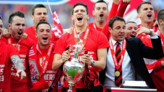 Captain Mark Hudson and manager Malky Mackay led the celebrations as Cardiff City celebrated their Championship title win and promotion to the Premier League.