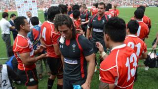 Wales players leave the field looking dejected after Japan claimed a historic first win in the second Test in Tokyo to draw the series after the tourists had won 22-18 in the first Test.