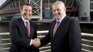 WRU chief executive Roger Lewis shakes the hand of Warren Gatland after the New Zealander signed a contract extension to remain Wales head coach until after the 2019 World Cup.