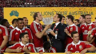 Injured Lions captain Sam Warburton and stand-in skipper Alun Wyn Jones kiss the glass trophy after the third Test win over Australia which clinched the series.