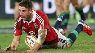 Wales wings Alex Cuthbert and George North scored tries as the British and Irish Lions beat Australia 23-21 to win the first Test.