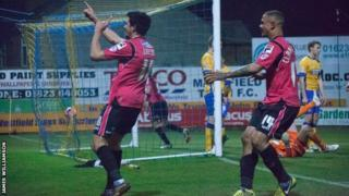 Matteo Lanzoni (left) celebrates scoring Oldham's third goal