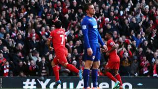 Luis Suarez celebrates Liverpool's opening goal during their Premier League match against Cardiff City