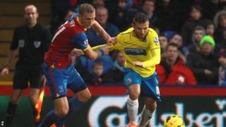 Crystal Palace's Dean Moxey (left) and Newcastle United's Yohan Cabaye
