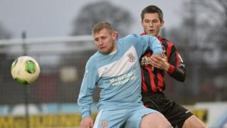David Cushley and Craig McClean vie for possession as Ballymena defeat Crusaders at the Showgrounds