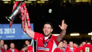 Alex Cuthbert celebrates winning the Six Nations after scoring two tries as Wales beat England