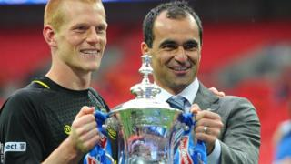 Ben Watson and Roberto Martinez celebrate after Wigan beat Manchester City 1-0 in the FA Cup Final