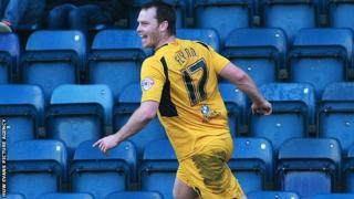 Newport County's Mike Flynn celebrates a goal