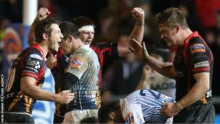 Dragons players celebrate at the final whistle of their match against Cardiff Blues