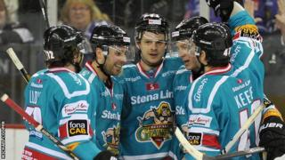 Craig Peacock (centre) is congratulated after scoring Belfast's late fourth goal on Friday night