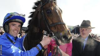 Hurricane Fly with jockey Ruby Walsh (l) and trainer Willie Mullins