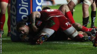 Ashley Beck scores the ospreys first try against the Scarlets